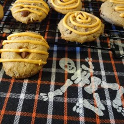 Chocolate Chip Pumpkin Spice Cookies Recipe - Pumpkin puree, spice cake mix, chocolate chips, and a few additional spices turn into a quick and easy egg-free treat.