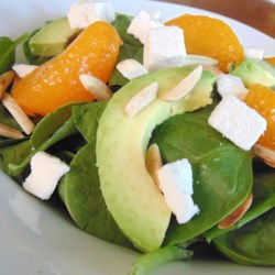Al's Favorite Spinach Power Salad Recipe - A simple mixture of lemon juice and olive oil makes the dressing for this spinach salad with avocado and almonds.