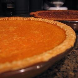 Sweet Potato Pie II Recipe - This sweet potato pie is made very creamy with evaporated milk and gets a bit of a kick with rum. Along with sugar, salt, cinnamon, nutmeg, eggs and butter, all the ingredients are put into a food processor and blended until very smooth. Then the filling goes into a pie crust and bakes for less than an hour.
