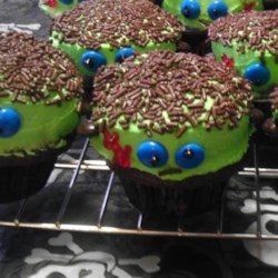 Frankenstein Cupcakes Recipe - Cupcakes are frosted with green frosting, chocolate candies, and food gel creating Frankenstein cupcakes perfect for Halloween parties.