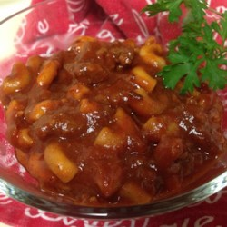 Country Goulash Recipe - This Americanized version of the classic Hungarian dish mixes ground beef and macaroni in a paprika-flavored tomato sauce mixture.