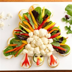 Crescent Turkey Shaped Veggie Platter Recipe - Charm your guests at Thanksgiving with this tasty turkey appetizer. Change up the veggies if you like!