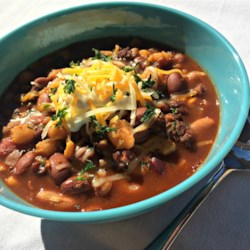 Slow Cooker Taco Bean Soup Recipe - A versatile crowd pleaser, this taco soup is packed with beef, beans, and flavor!