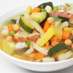 Hearty Chicken Vegetable Soup III Recipe - Chicken wings, hominy, jalapenos, squash -- you name it, it's in this hearty vegetable chicken soup.