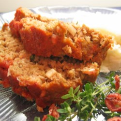 Rosemary Turkey Meatloaf Recipe - A tasty turkey meatloaf boldly seasoned with rosemary and Dijon mustard is the perfect meal for those trying to cut back on red meat.
