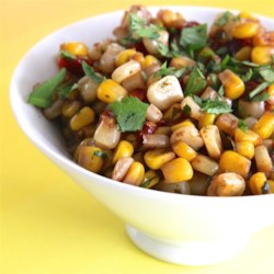 Corn and Roasted Red Pepper Salad Recipe - This sweet-and-sour corn salad makes a great accompaniment for any Tex-Mex meal.