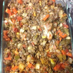 Lentil Casserole Recipe - Lentils and veggies are baked under a layer of low-fat Cheddar cheese creating a vegetarian lentil casserole that is easy to prepare.