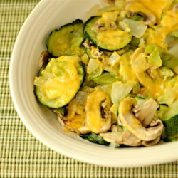 Steamy Microwave Zucchini Recipe - This recipe makes a cheesy vegetable side dish very easily. Just steam zucchini, onion, celery, and mushrooms in the microwave and mix with Cheddar!