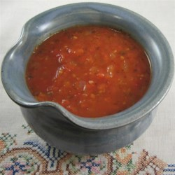 Fresh Tomato Marinara Sauce Recipe - Homemade tomato sauce is a great way to use your garden's bounty of tomatoes. This recipe uses plenty of herbs and is vegetarian-friendly.
