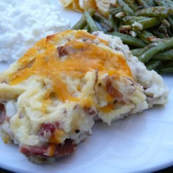 Alisha's Scalloped Potatoes and Ham Recipe - Cooked potatoes are partially mashed to make a creamy casserole with chunks of ham dotted throughout.
