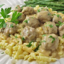 Swedish Meatballs (Svenska Kottbullar) Recipe - Swedish meatballs made with ground beef and pork are gently spiced, baked, and served with brown sour cream gravy in this old family favorite.