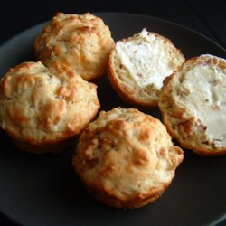 Bacon Cheddar Chive Muffins Recipe - This tangy, savory muffin features Cheddar, Parmesan, bacon, chives and garlic. Cream of mushroom soups helps ensure a moist result.