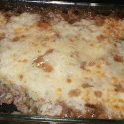 French Onion Casserole Recipe - This is so easy to make and tastes great. My family just loves it and yours will, too! It includes ground beef, rice, celery, green onions and green peppers, all combined and baked in a creamy soup-based sauce.