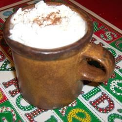 Colonial Hot Buttered Rum Recipe - This is the real thing - an authentic Colonial recipe except you use a slow cooker to simmer it. You will swear you are drinking a cinnamon roll and then it hits you! Very tasty and a family favorite.