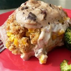 Stuffed Pork Chops II Recipe - Tender pork chops stuffed with corn and bread crumbs and smothered in a savory mushroom sauce.