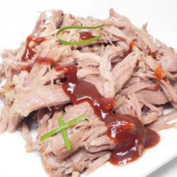 Beer Pulled Pork Recipe - Pork shoulder is slowly cooked in beer until tender. All you need is onion and some salt and pepper for this tasty sandwich filling.