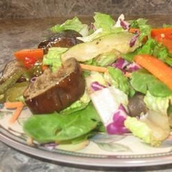 Emily's Famous Roasted Vegetable Salad Recipe - This is a delicious vegetable salad made with eggplant, yellow squash, asparagus and red pepper. It is colorful as well as flavorful.