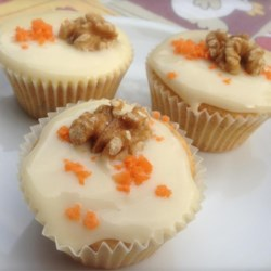 Carrot Cupcakes Recipe - Carrot cupcakes made with finely ground walnuts are a similar version of carrot cake but a little bit smoother; serve with your favorite cream cheese frosting.