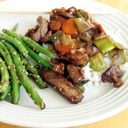 Mongolian Beef I Recipe - A simple but spicy dish with beef, carrots and green onions. Serve over rice for a very filling meal.
