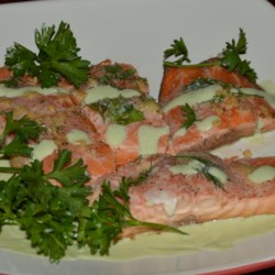 Poached Salmon II Recipe - This dish is simple, moist and delicious. You may substitute lemon juice for the wine and omit the garlic if you wish.