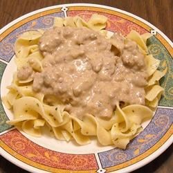 Stroganoff Recipe - A simple, inexpensive version of a popular dinner entr Ee. Sauteed ground beef and onions are combined with paprika, cream of mushroom soup, and sour cream, then served over egg noodles.