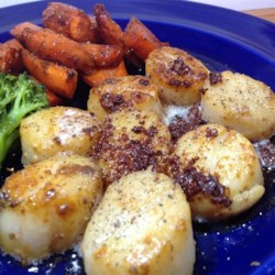 Buzzard's Bay Bourbon Scallops Recipe - Saute scallops in butter and bourbon, then top with a bourbon sauce to create this delicious, quick-and-easy recipe that is a guaranteed crowd-pleaser.