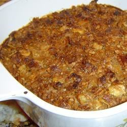 Yam Casserole Recipe - Yams are baked with butter, sugar, evaporated milk, eggs and spices,  and topped with a mixture of butter, brown sugar and sugar frosted corn flake cereal.