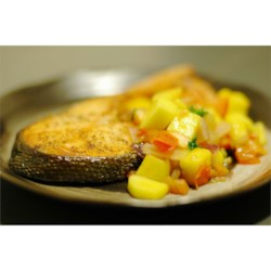 Mango Salsa Salmon Recipe - Broiled salmon steaks are topped with a delicious mango and tomato salsa.
