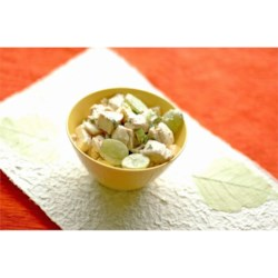 Carol's Chicken Salad Recipe - Tender chicken breast chunks are mixed with sweet green grapes, diced Swiss cheese, crunchy celery, and minced green onions, and folded into a tangy, creamy dressing.