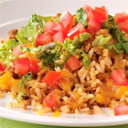One-Pan Taco Dinner Recipe - Enjoy the flavor of tacos without all the mess! This recipe combines ground beef, taco seasoning, Minute(R) Rice, shredded cheese, lettuce and tomato in a single skillet.