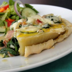 Spinach and Courgette Quiche Recipe - Spinach and courgette quiche with hints of bacon and onion is a delightful brunch item that is ready in 1 hour.