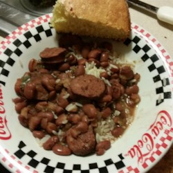 Slow Cooker Red Beans and Rice Recipe - The ultimate comfort food: red beans cooked slow, then served over rice.