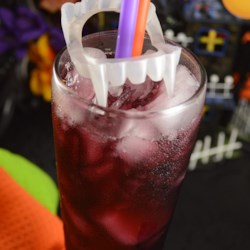 Liquid Vampire Recipe - Treat your Halloween guests to a liquid vampire: Cabernet Sauvignon, cranberry juice, and raspberry schnapps served over ice. It's ghoulishly delightful!