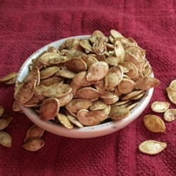 Sweet Vanilla Cinnamon Pumpkin Seeds Recipe - These sweet pumpkin seeds are baked with vanilla bean sugar and cinnamon.