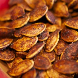 Roasted Cinnamon Spice Pumpkin Seeds Recipe - Season your pumpkin seeds with cinnamon, sugar, and ginger with this recipe that is a hit with the whole family!