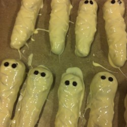 Halloween Mummy Cookies Recipe - These white chocolate-coated cocoa cookies are frightfully delicious! Kids love to help form the chilled dough into the mummy shapes.