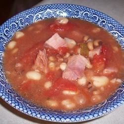 New Year's Day Black-Eyed Peas Recipe - See in the new year with a hearty bowl of black-eyed peas cooked with garlic, onion, tomatoes and diced country ham. A real country ham is quite salty, but the flavor and seasoning is just right for this homey dish.