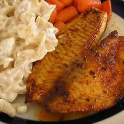 Blackened Tilapia with Secret Hobo Spices Recipe - Tilapia fillets are rubbed with a mix of secret spices, then pan fried and served on white bread with a squeeze of lemon juice.