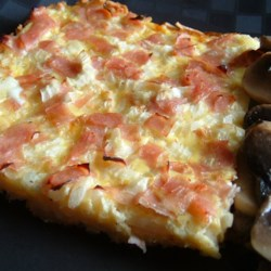 Ham and Cheese Breakfast Quiche Recipe - Bake a ham and cheese quiche in a pan lined with crispy hash brown potatoes instead of the usual pastry shell.