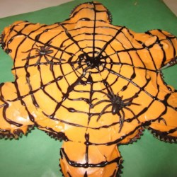 Pull-Apart Spider Web Cupcakes Recipe - Treat your family and friends to the perfect Halloween dessert; pull-apart spider web cupcakes frosted with whipped topping.
