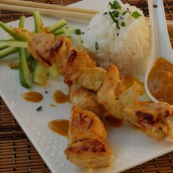 Chicken Satay With Peanut Sauce Recipe - Flavorful Thai-style chicken skewers are topped with a sweet and spicy peanut sauce. Serve with white rice for a complete meal!