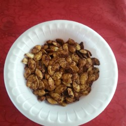 Cajun Spiced Roasted Pumpkin Seeds Recipe - A hint of Cajun seasoning spices up these savory pumpkin seeds. Wash away as much pulp as possible from your seeds and dry them beforehand. Recipe is easily doubled or tripled.