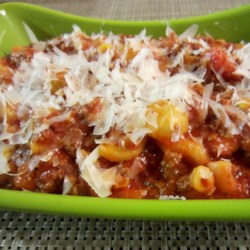 Kicked-Up Goulash Recipe - This mixture of beef and macaroni uses prepared spaghetti sauce, pearl onions, corn, and Italian seasoning for an easy dinner for the whole family.