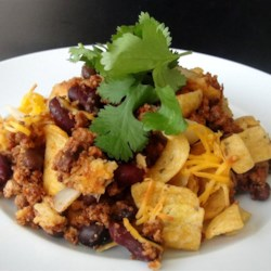 Bethany's Frito(R) Pie Recipe - Corn chips, chili, Cheddar cheese, and onion are all you need to make this hearty, budget-friendly casserole.