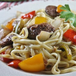 Linguine with Peppers and Sausage Recipe - A quick saute of tasty Italian sausage with sliced bell peppers, onion, garlic and wine makes a terrific meal when tossed with hot linguine and a grating of Parmesan cheese.