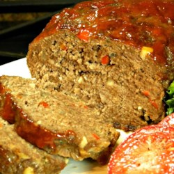 Mac's Magnificent Meatloaf Recipe - Mac's magnificent meatloaf includes ground sirloin baked with sauteed vegetables and is topped with a spicy ketchup glaze.