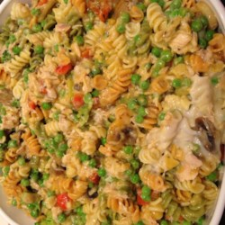 Tuna Noodle Casserole III Recipe - Colorful carrots, broccoli and red bell peppers find their way into a familiar casserole of tuna, celery, onion and cream of mushroom soup. Sprinkle with Cheddar cheese and bake until warm and bubbly.