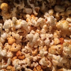 Spicy Sweet Stovetop Popcorn Recipe - Coconut oil, agave nectar, and chipotle chile powder create a sweet and spicy treat ready in minutes.