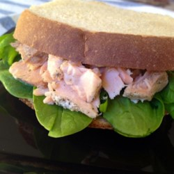 Simple Salmon and Spinach Sandwiches Recipe - Make a simple salmon salad with canned salmon and thousand island dressing, and serve on toast with spinach leaves.