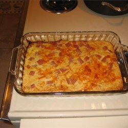 Spam and Cheese Casserole Recipe - A mixture of the famed luncheon meat, eggs, soda cracker crumbs, milk and Cheddar cheese baked to a full flavored finish.